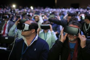 Attendees use the new Samsung Gear 360, a 360-degree camera, during the Samsung Galaxy Unpacked 2016 event on the eve of this week's Mobile World Congress wireless show, in Barcelona, Spain, Sunday, Feb. 21, 2016.  (AP Photo/Manu Fernadez)