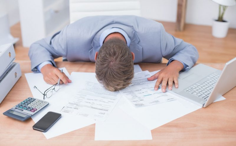 42577161 - businessman being depressed by accounting in his office