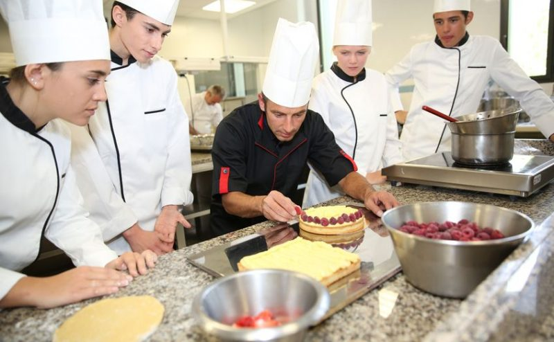 20691683 - students with teacher in pastry training course