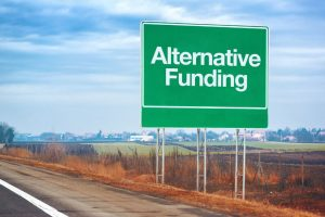 53030035 - alternative funding on road sign, entrepreneurship and business concept with road sign by the highway