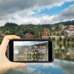 51728318 - taking photo on smart phone. building along lake in sapa city, lao cai, vietnam