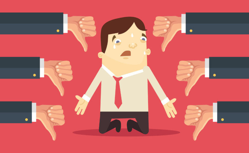 48675349 - sad businessman and many hands with thumbs down. vector flat illustration