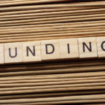 90903990 - funding word written on wooden cubes. finance concept. money