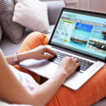 43940598 - woman using laptop to book hotel online
