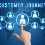 29731537 - customer journey concept with hand pressing social icons on blue world map background.